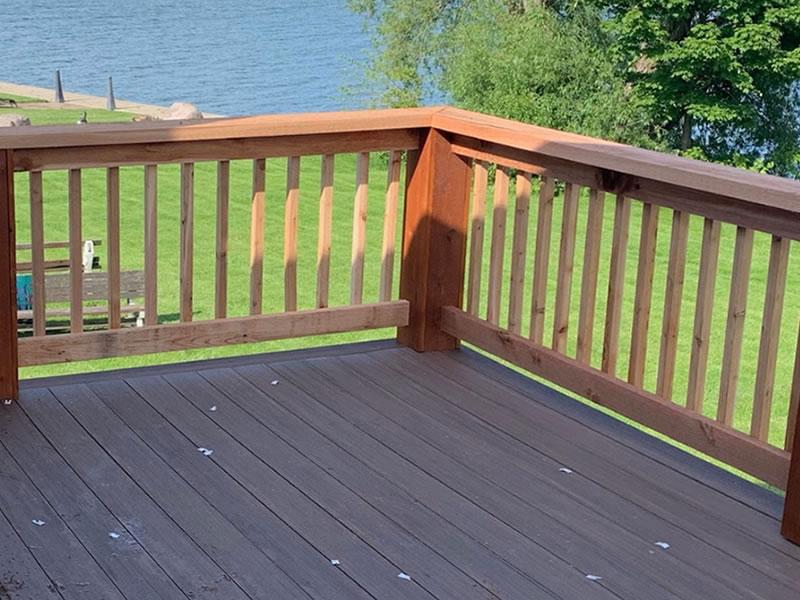 Composite decking with cedar rails